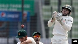 FILE: Zimbabwean cricketer Sikandar Raza, left, bats, as Bangladesh's captain Mushfiqur Rahim cups his hands to catch the ball during the first day of the first cricket test match in Dhaka, Bangladesh, Saturday, Oct. 25, 2014. (AP Photo/A.M. Ahad)