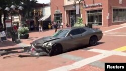 A vehicle is seen reversing after plowing into the crowd gathered on a street in Charlottesville, Virginia, U.S., after police broke up a clash between white nationalists and counter-protesters, Aug. 12, 2017, in this still image from a video obtained fro