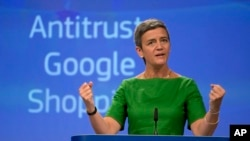 European Union Commissioner for Competition Margrethe Vestager speaks during a media conference at EU headquarters in Brussels on Tuesday, June 27, 2017. The European Union's competition watchdog has fined internet giant Google over its online shopping service. (AP Photo/Virginia Mayo)