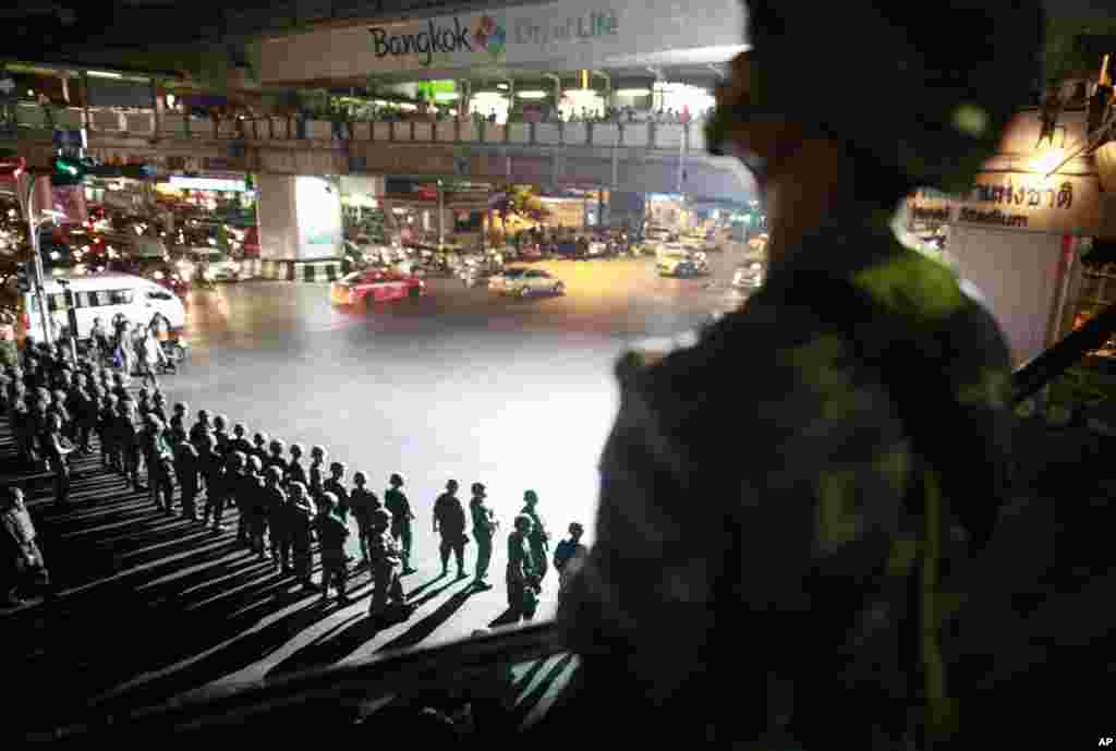 Thai soldiers secure an intersection in downtown Bangkok to prevent pro-government demonstrators from gathering to protest against the coup.