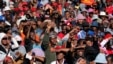 Supporters of South Africa's Economic Freedom Fighters (EFF) listen to their leader Julius Malema during his campaign, ahead of the August 3 local government elections, in Etwatwa, a township near Benoni, South Africa, July 27, 2016.