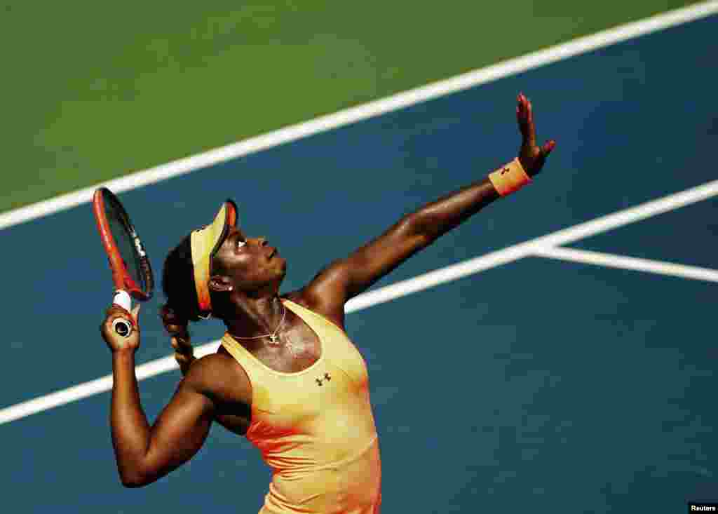 Sloane Stephens of the U.S. serves to Agnieszka Radwanska of Poland during the women's tennis match at day four of the Rogers Cup tennis tournament in Toronto, Canada.