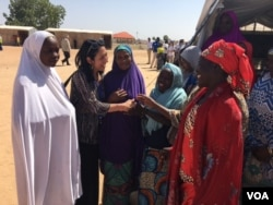 U.S. Deputy UN Ambassador Michelle Sison talks to women in the Maiduguri camp. (M.Besheer/VOA)