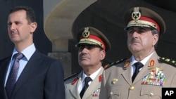 Սիրիայի պաշտպանության նախարար Դաուդ Ռաջհա (աջից, արխիվային լուսանկար)