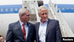 U.S. Defense Secretary Chuck Hagel (R) is greeted by U.S. Ambassador to Singapore Kirk Wagar upon his arrival in Singapore May 30, 2014.