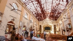 Dead bodies of victims lie inside St. Sebastian's Church damaged in blast in Negombo, north of Colombo, Sri Lanka. April 21, 2019)