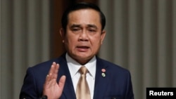 Thai Prime Minister Prayuth Chan-Ocha requests the king to end martial law.