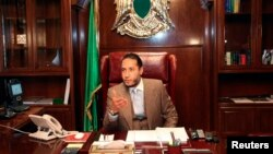 FILE - Saadi Gadhafi, a son of Libyan leader Muammar Gadhafi, speaks during a news conference at his office in Tripoli January 31, 2010.