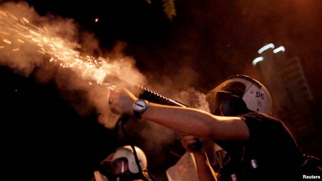 Riot police fire tear gas toward protesters during clashes in Kennedy Street in central Ankara, Turkey, June 18, 2013.