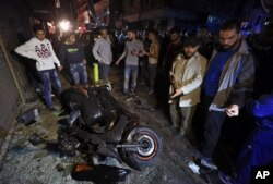 People gather near the site of a twin suicide attack in Burj al-Barajneh, southern Beirut, Lebanon, Nov. 12, 2015.