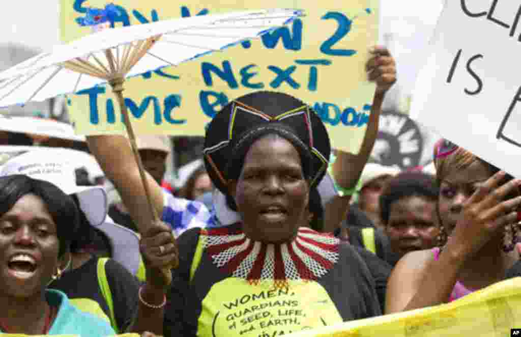 Environmental activists demonstrate outside the United Nations Climate Change conference (COP17) in Durban December 3, 2011. The protest march was part of a Global Day of Action to demand a fair climate change deal. REUTERS/Rogan Ward