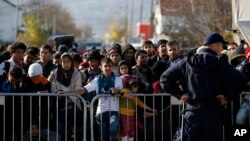 FILE - Migrants wait to register with police at a refugee center in the southern Serbian town of Presevo, Nov. 16, 2015. Newly elected Canadian Prime Minister Justin Trudeau will announce Tuesday his plan to resettle 25,000 Syrian refugees.