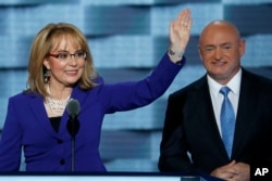 FILE - Former Rep. Gabby Giffords, D-Ariz., and her husband, retired astronaut Mark Kelly, speak during the third day of the Democratic National Convention in Philadelphia, July 27, 2016.