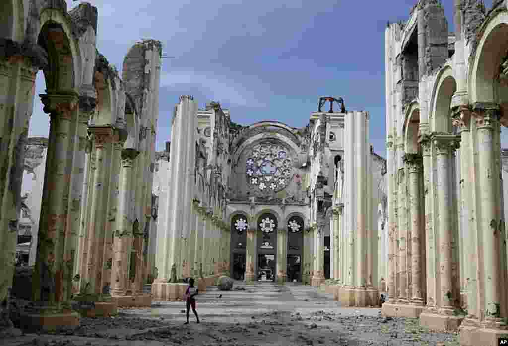 A youth walks inside the earthquake damaged Cathedral in Port-au-Prince, Haiti, January 7, 2012. (AP)
