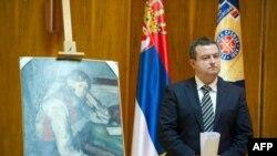 Ministar policije Ivica Dačić pored ukradene slike Pola Sezana