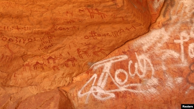 Vandalized rock art is pictured at Tadrart Acacus, in Ghat, Libya, May 30, 2014.