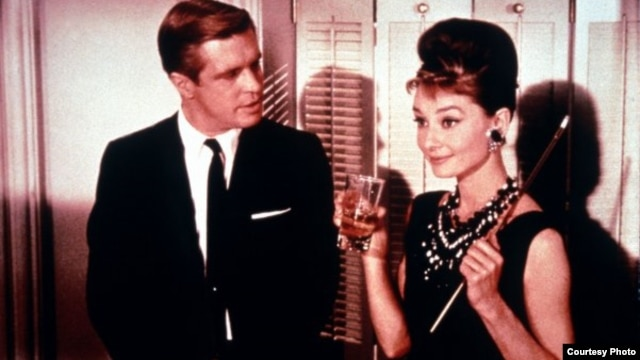 Publicity still of Audrey Hepburn, George Peppard in Breakfast at Tiffany's - Copyright Paramount Pictures