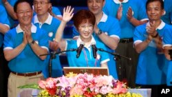 Backed by the ruling Nationalist Party members, Hung Hsiu-chu, a former teacher and current deputy legislative speaker, waves as she is nominated as the party's candidate in the January presidential election, July 19, 2015, in Taipei, Taiwan.