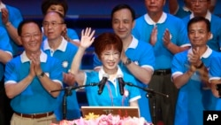 Backed by the ruling Nationalist Party members, Hung Hsiu-chu, deputy legislative speaker, waves as she is nominated as the party's candidate in the January presidential election, July 19, 2015, in Taipei, Taiwan.