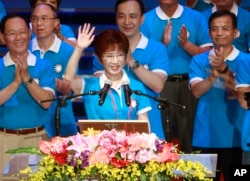 FILE - Backed by the ruling Nationalist Party members, Hung Hsiu-chu, a former teacher and current deputy legislative speaker, waves as she is nominated as the party's candidate in the January presidential election, July 19, 2015, in Taipei, Taiwan.
