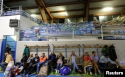 People rest following an earthquake in Amatrice, central Italy, Aug. 24, 2016.