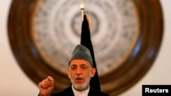 FILE - Outgoing Afghan President Hamid Karzai speaks during a gathering of government employees in Kabul Sept. 23, 2014.