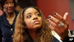 FILE - Civil rights activist Tamika Mallory speaks at a news conference in New York, Oct. 17, 2017. Mallory has accused an American Airlines pilot of racial discrimination in kicking her off a flight. The NAACP is warning African-Americans that if they fly on American Airlines they could be subject to discrimination or even unsafe conditions.