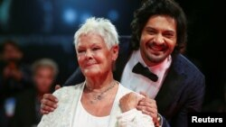 "Actors Ali Fazal and Judi Dench pose during a red carpet for the movie ""Victoria and Abdul"" at the 74th Venice Film Festival in Venice, Italy, Sept. 3, 2017."