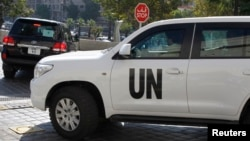 U.N. vehicles carrying chemical weapons experts leave their hotel in Damascus October 5, 2013.