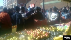 Vendors captured Wednesday after they were evicted from the Harare central business district.