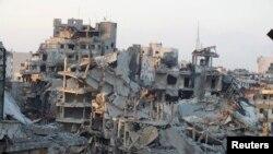 지난 달 13일 폐허로 변한 홈스 시가지의 붕괴된 건물 모습