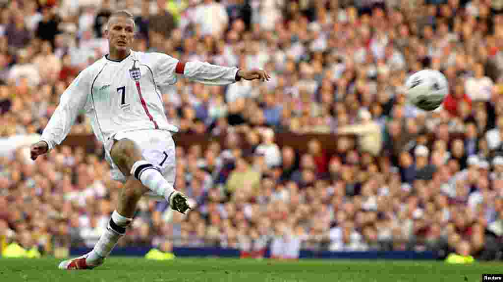 Retiriing David Beckham of England scores from a free kick to equalise against Greece in their World Cup Group Nine qualifying match, October 6, 2001.