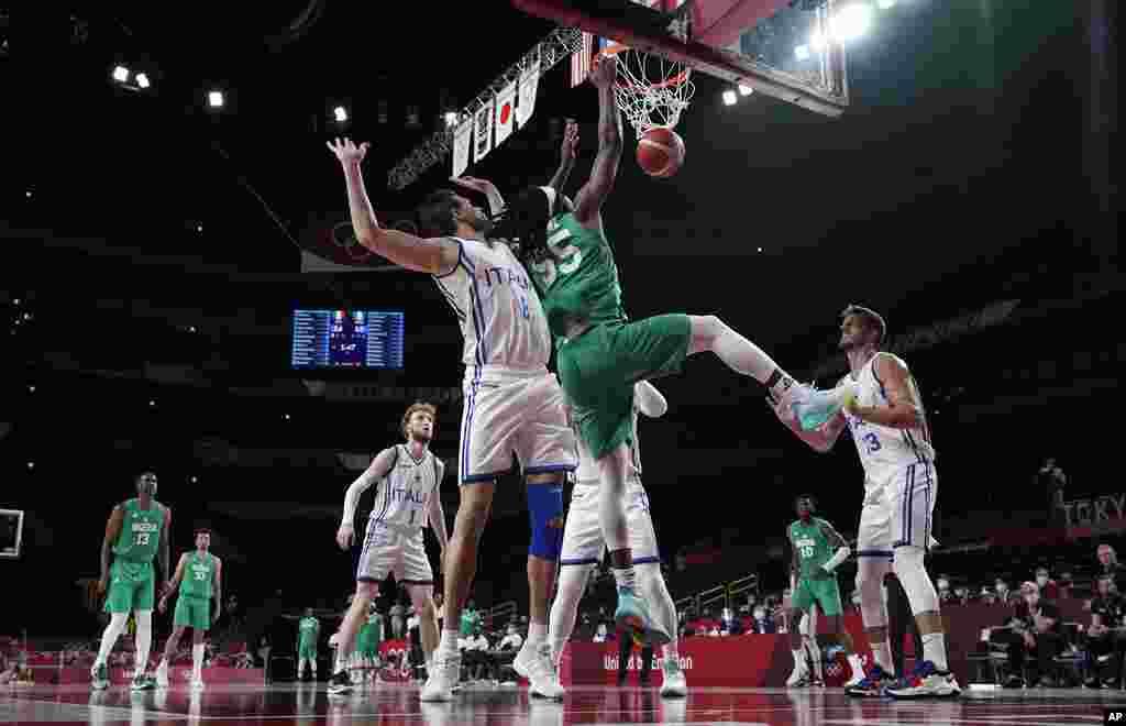 Nigeria's Precious Achiuwa (55) scores past Italy's Danilo Gallinari (8) during men's basketball preliminary round game at the 2020 Summer Olympics, Saturday, July 31, 2021, in Saitama, Japan. (AP Photo/Eric Gay)