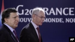 European Commission President Jose Manuel Barroso, left, and European Council President Herman Van Rompuy arrive at a G20 meeting in Cannes, Thursday, Nov.3, 2011.
