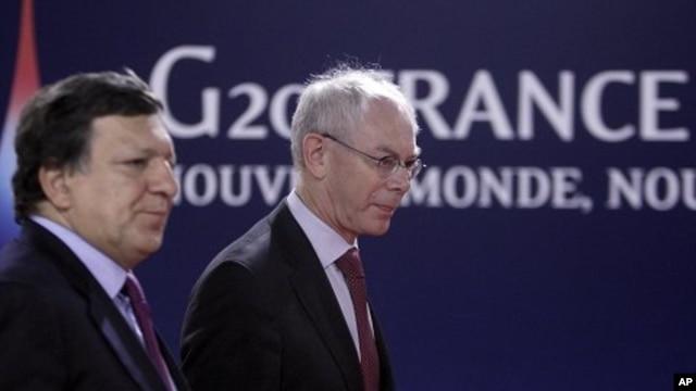European Commission President Jose Manuel Barroso, left, and European Council President Herman Van Rompuy arrive at a G20 meeting in Cannes, Thursday, Nov.3, 2011.