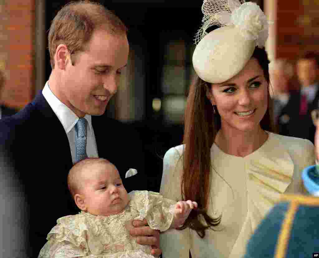 Britain's Prince William and Kate, Duchess of Cambridge, with their son Prince George arrive at Chapel Royal in St James's Palace in London, for the christening of the three month-old Prince George.