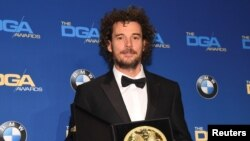 "Garth Davis, winner of the First-Time Feature Film award for his work on ""Lion,"" poses for photographers at the 69th annual DGA Awards in Beverly Hills, California, Feb. 4, 2017."
