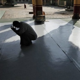 A Burmese man prays at a temple in Bago, northeast of Rangoon, on Election Day.
