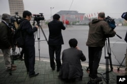 Foreign journalists are seen filming the April 25 House of Culture, the venue for the seventh Congress of the Workers' Party of Korea, in Pyongyang, North Korea, May 6, 2016.