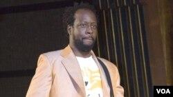 Penyanyi hip-hop Wyclef Jean, saat tampil dalam pertunjukan konser PBB untuk penggalangan dana bagi pemberantasan HIV/AIDS.