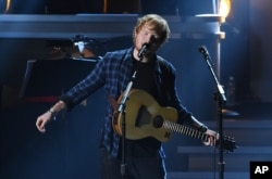 "FILE - Ed Sheeran performs at ""Stevie Wonder: Songs in the Key of Life - An All-Star Grammy Salute,"" at the Nokia Theatre L.A. Live on Feb. 10, 2015, in Los Angeles."