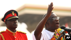 Ghana's new President John Atta Mills, right, gestures as he speaks after being sworn in as the country's new president during a ceremony in Accra, Ghana Wednesday, Jan. 7, 2009.