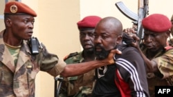 FILE - Troops arrest CAR MP Alfred Yekatom after he fired the gun at the parliament in Bangui, Oct. 29, 2018. Yekatom was extradited Nov. 17, 2018, to The Hague, The Netherlands, after an arrest warrant was issued by the International Criminal Court.