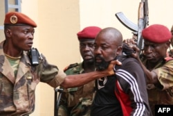 FILE - Members of the armed forces arrest Central African Republic MP Alfred Yekatom after he fired a gun at the parliament in Bangui, Oct. 29, 2018.