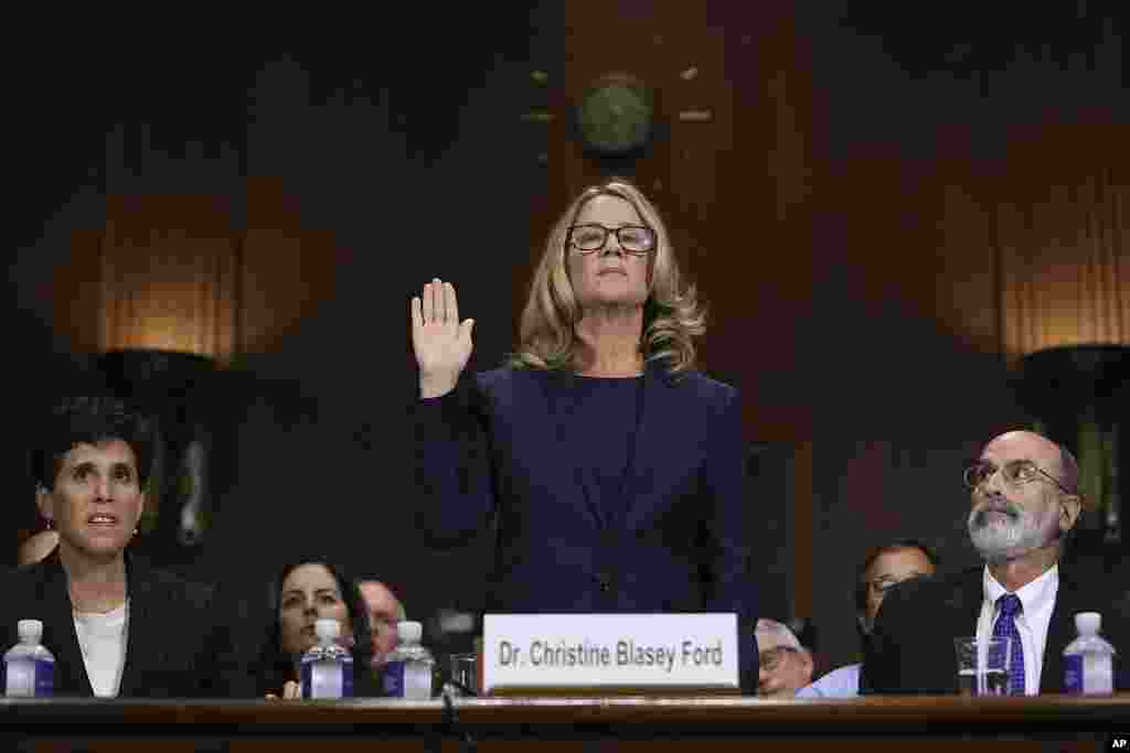 Christine Blasey Ford is sworn in before the Senate Judiciary Committee, in Washington, D.C. Dr. Ford, who accused Supreme Court nominee Brett Kavanaugh of sexually assaulting her decades ago, provided detailed and emotional testimony before the panel.