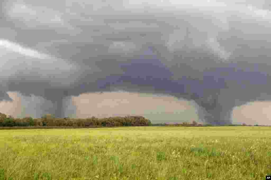 Two tornados approach Pilger, Nebraska, June 16, 2014. The National Weather Service said at least two twisters touched down within roughly a mile of each other in northeast Nebraska.