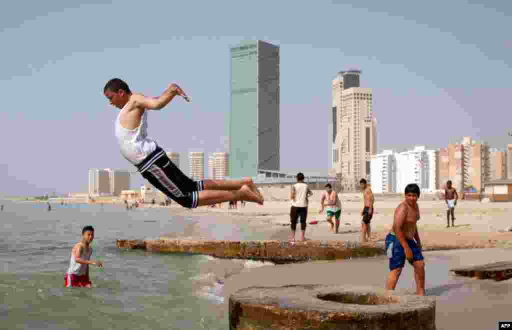 May 3: Libyans enjoy a day on a beach in Tripoli, Libya. (AP Photo/Darko Bandic)