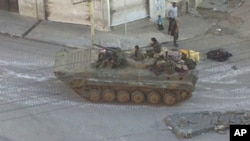 A Syrian army tank is seen in the Zabadani neighborhood of Damascus (file photo)