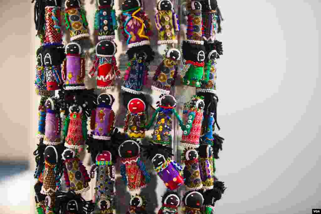 The Orphan Tower, a tower of small beaded cloth dolls, is set up at the AIDS conference. The tower signifies the number of young children orphaned by AIDS in South Africa -- the current number is 3.7 million. (Alison Klein/VOA)