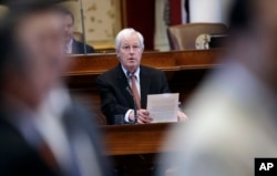 Texas Rep. Charlie Geren, R-Fort Worth, answers questions as the Texas House debates an anti-sanctuary-cities bill that seeks to jail sheriffs and other officials who refuse to help enforce federal immigration law, in Austin, April 26, 2017. The Legislature completed approval of the bill May 3, 2017.